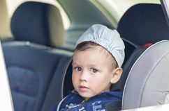 Safety Concept: Portrait of Young Caucasian happy Little Boy Sit Royalty Free Stock Image