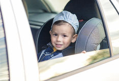 Safety Concept: Portrait of Young Caucasian happy Little Boy Sit Royalty Free Stock Photography