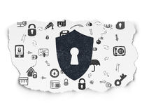 Safety concept: Shield With Keyhole on Torn Paper Royalty Free Stock Images