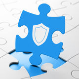 Safety concept: Shield on puzzle background Royalty Free Stock Photos