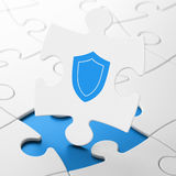 Safety concept: Shield on puzzle background Royalty Free Stock Photography