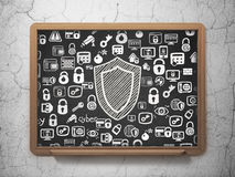 Safety concept: Shield on School Board background Royalty Free Stock Photography