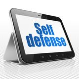 Safety concept: Tablet Computer with Self Defense on display Stock Photo