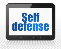 Safety concept: Tablet Pc Computer with Self Defense on display Stock Image