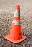 Safety Cone Blurry Background. An orange road cone Royalty Free Stock Photos