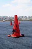 Safety cone. S get dirty by drifting car Stock Photos
