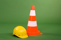 Safety cone and helmet. Royalty Free Stock Photos