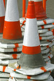 Safety cones. Piles of reflective traffic safety cones for highway maintenance royalty free stock images