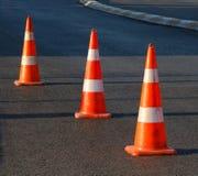 Safety Cones. Orange afety cones on asphalt Stock Photos