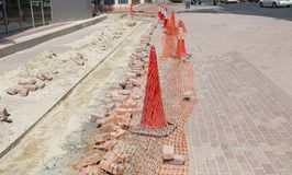 Safety cones in city road. Construction royalty free stock image