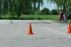 Safety Cones. Orange safety cone on asphalt royalty free stock photo