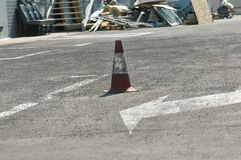 Safety Cones. Orange safety cone on asphalt royalty free stock image