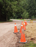 Safety Cones. Saftey cones in rural setting beside road way Royalty Free Stock Images