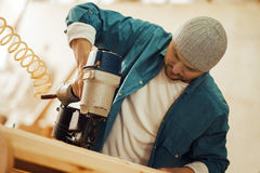 Safety-conscious contractor or homeowner working with nail gun Royalty Free Stock Photo