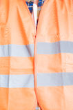 Safety construction concept with orange protection vest in close Royalty Free Stock Images