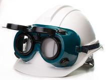 Safety construction hat and goggles Stock Photos