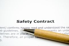 Safety contract with wooden pen stock photos
