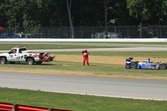 Safety crew assists race car Royalty Free Stock Photo