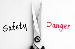 Safety and Danger words with scissors in middle Stock Images