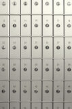 Safety deposit boxes. Front view of closed safety deposit boxes Stock Image