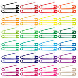 Safety and diaper pins in colors - vector Royalty Free Stock Image
