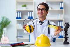 The safety doctor advising about noise cancelling headphones. Safety doctor advising about noise cancelling headphones stock photos