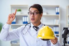 The safety doctor advising about wearing hard hat stock images