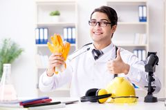 The safety doctor advising about wearing protective gloves royalty free stock photos