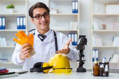 The safety doctor advising about wearing protective gloves stock photos