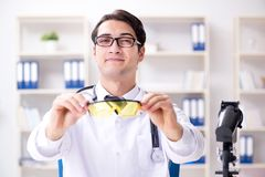 The safety doctor advising about wearing protective goggles royalty free stock photo