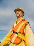 Safety dummy. Mannequin wearing a yellow and orange safety gear royalty free stock photos