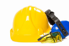 Safety equipement. Helmet and ear protectors and glasses isolated on white background Royalty Free Stock Images