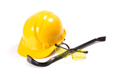 Safety equipemet and tools. Safety equipement, helmet, glasses, and working tools crowbar isolated on white background Royalty Free Stock Image