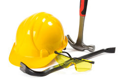 Safety equipemet and tools. Safety equipement, helmet, glasses, and working tools hammer and crowbar isolated on white background Royalty Free Stock Image