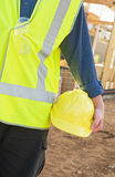 Safety equipment. A young worker at the construction site with safety equipment Royalty Free Stock Photography