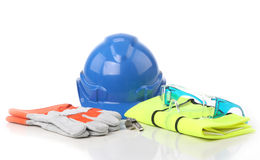 Safety equipment. S, blue helmet, safety glooves, wistle,safety vest, goggle, in  white Royalty Free Stock Images
