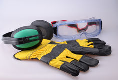 Safety Equipment. Gloves, goggles and ear defenders Stock Photos