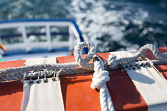 Safety equipment on the boat. Red and White Safety equipment on the sail boat Stock Image