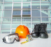 Safety equipment on green glass background Stock Photos