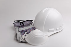 Safety equipment hard hat glasses glove and mask. Hard hat hardhat with leather gloves on white background room for text personal protective equipment leather Royalty Free Stock Photos