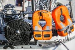 Safety equipment of modern yacht. Orange lifebuoys and black rope, safety equipment of modern yacht Stock Photo