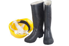 Safety equipment PPE. Isolated image of hard hat and steel toe boots Royalty Free Stock Images