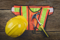 Safety equipment and tool kit on wooden background Stock Image