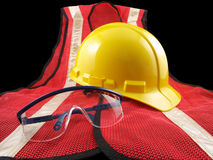 Safety Equipment Trio. Trio of personal safety equipment.  Hard hat, glasses and orange vest Royalty Free Stock Photos