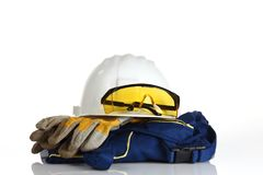 White helmet safety equipment. Safety equipment on white background Royalty Free Stock Photo