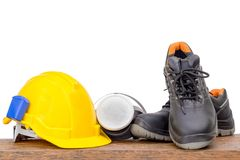 Safety equipment on wood background. Selective focus Royalty Free Stock Photos