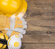 Safety equipment on wooden background Royalty Free Stock Photo