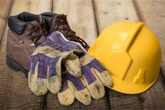 Safety equipment. Work boot hardhat protective workwear work glove safety boot Royalty Free Stock Images