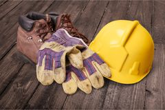Safety equipment. Work boot hardhat protective workwear work glove safety boot Royalty Free Stock Photos