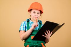 Safety expert. Foreman planning. Builder engineer architect. Future profession. Kid builder girl. Build your future. Yourself. Initiative child girl hard hat stock photos